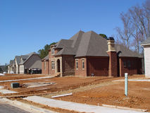 Home Construction. Upper Middle Income homes under construction in a subdivison Royalty Free Stock Image