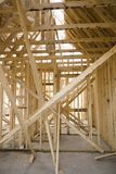 Home construction 2. Looking inside a house under construction. Framing elements Royalty Free Stock Photo