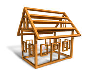 Home Construction. With the wood frame structure of a house being built in a working site as a builder concept for the housing and real estate industry on a Royalty Free Stock Image