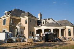 Home Construction. Large upscale home under construction Stock Photography