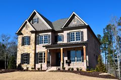 New home constructed in Watkinsville Georgia. Home construction is booming at local counties in Georgia. A newly constructed home for sale at Watkinsville Stock Photography