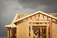 Home Construction Framing with Ominous Clouds Stock Photography