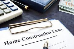 Home construction loan policy and money. Home construction loan policy and money on the table royalty free stock photos