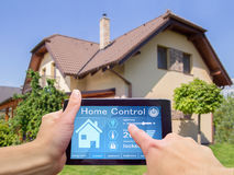 Home control device tablet. Hands holding tablet device for home house control Royalty Free Stock Photos