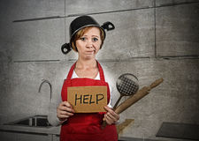 Home cook woman confused and frustrated in apron and cooking pot as helmet asking for help. Beautiful cook woman confused and frustrated face expression wearing Royalty Free Stock Images