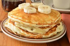 Home cooked pancakes with bananas. A stack of home cooked pancakes with sliced bananas Royalty Free Stock Photo