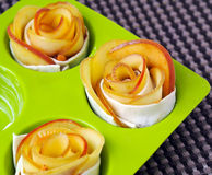 Home cooking – rose-shaped apple tarts Stock Photo