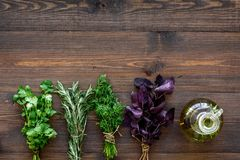 Home cooking with fresh greenery and organic oil on wooden table background top view mock up stock images