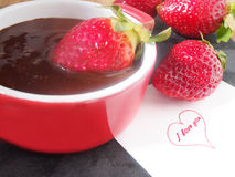 Home cooking, fresh juicy strawberries with melted dark chocolate Royalty Free Stock Image