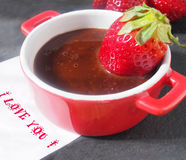 Home cooking, fresh juicy strawberries with melted dark chocolate Royalty Free Stock Photo