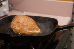 Home cooking for healthier eating. Boneless chicken with spices cooking in the skillet Stock Photography
