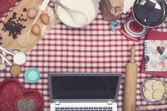 Home cooking laptop hero header Stock Images