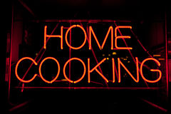 Home cooking neon sign at city restaurant. City sign for fresh home cooking royalty free stock photo