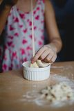 Home cooking noodles. In the kitchen with her grandmother Royalty Free Stock Image