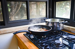 Home Cooking - pan and pot. Home kitchen - stove with cooking pan and pot royalty free stock photos