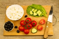 Home cooking summer Greek salad on wooden background Royalty Free Stock Images