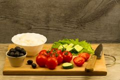Home cooking summer Greek salad on wooden background Royalty Free Stock Photo