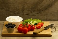 Home cooking summer Greek salad on wooden background Royalty Free Stock Photography