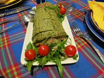 Home cooking. Traditional Easter brunch - Spinach roll with salmon Royalty Free Stock Photography