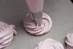 Home Cooking Zephyr or Marshmallow or Meringue. Pink Strawberry Dessert. Push the Cream on Baking Paper. Stock Photography