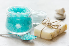 Home cosmetic with cream and blue sea salt on stone background Royalty Free Stock Image