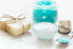 Home cosmetic with cream and blue sea salt on stone background Stock Images