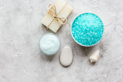 Home cosmetic with cream and blue sea salt on stone background top view mock-up Royalty Free Stock Photos