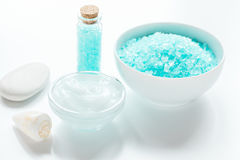Home cosmetic with cream and blue sea salt on white background Stock Images