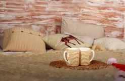 Home cozy and warm winter bedroom interior with cup of coffee Royalty Free Stock Photos