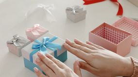 Home craft business gift boxes handmade jewelry. Home craft business. Gift boxes. Handmade jewelry. Woman arranging presents stock footage