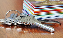 Home or credit?. A macro of home key in front of at stack of credit cards Stock Images