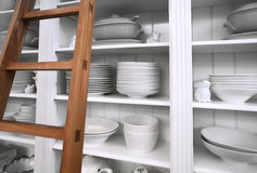 Home cupboard with dishes Royalty Free Stock Images