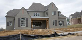 Home in Dark Gray Under Construction in Suburbia Royalty Free Stock Photography
