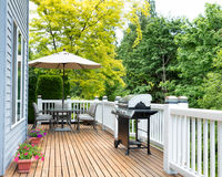 Home deck and patio with outdoor furniture and BBQ cooker Stock Images