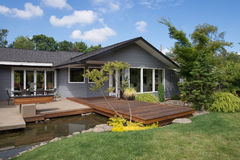 Home with Deck and Water Royalty Free Stock Photos