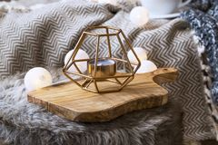 Home deco indoor with candle holder and light bulbs, cozy blanke. T and faux fur,cozy winter interior details Royalty Free Stock Photography