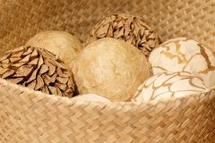 Natural Decorative Balls in A Wooden Basket Stock Image