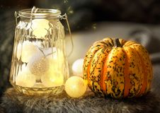 Home decor with pumpkin and lights Royalty Free Stock Photos