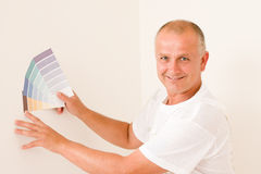 Home decorating mature male painter color swatches Stock Images