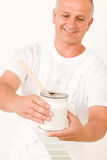 Home decorating mature male painter mix color Stock Images