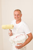 Home decorating mature man with paint roller Stock Images