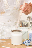 Home decorating mixing up paint color can Stock Photo