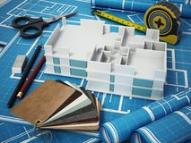 Home decorating tools standing on house bluprints. 3D illustration.  Stock Image