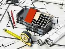 Home decorating tools standing on house bluprints. 3D illustration.  Stock Photography