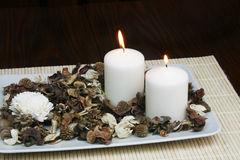 Home decoration. Decorative plate with dried flowers and burning candles - home decoration concept Stock Photography