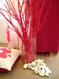 Home decoration. Twigs in vase with pillows for home decoration royalty free stock images