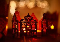 Home Decoration Candle Light, Christmas Lighting House Decor. Home Decoration in Candle Light, Christmas Abstract Lighting House Decor over De Focused Lighting Stock Photos