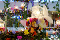 Home decoration with flower, butterfly & lights. Artificial decorations in a building with colorful flowers, white butterfly and lights. Celebrating the joy and Stock Photography