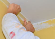 Home decoration, painting walls. Protect the ceiling with masking tape stock photo