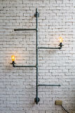 Home decoration pipes light bulb with white wall.  stock photos